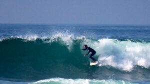 filippo-lera-surf-sup-instructor-ericeira-portugal-praia-do-mataduro-surf-riding-malika-surf-school-2019-tube-riding